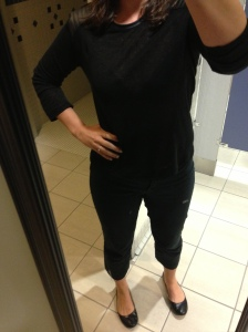 Black shirt, black pants, black flats