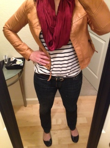 jeans, black and white striped shirt, tan jacket, red scarf