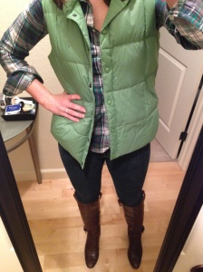 green vest, green flannel shirt, jeans, brown boots