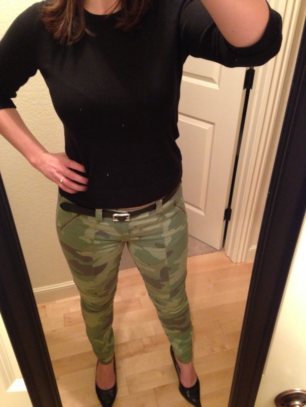 Black sweater, camo jeans