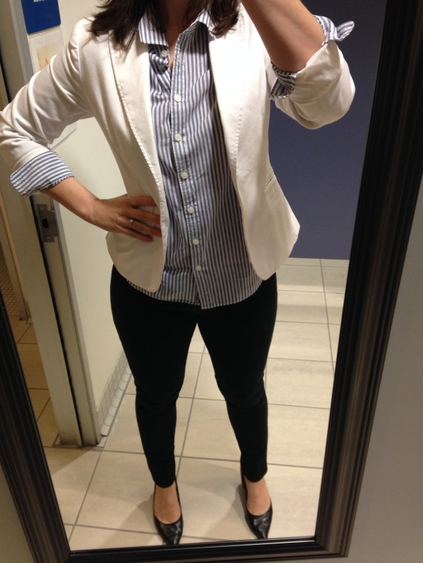 white blazer, blue and white collared shirt, black jeans