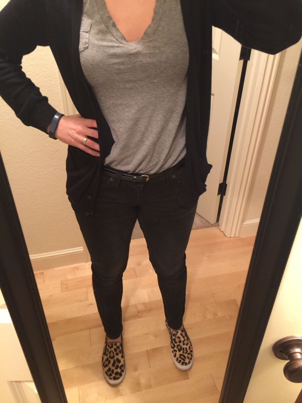 Black cardigan, gray tee, black jeans, black belt, leopard print slip-ons