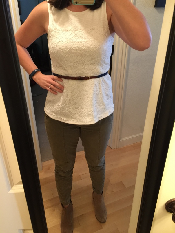 White peplum top, navy belt, olive jeans, suede boots