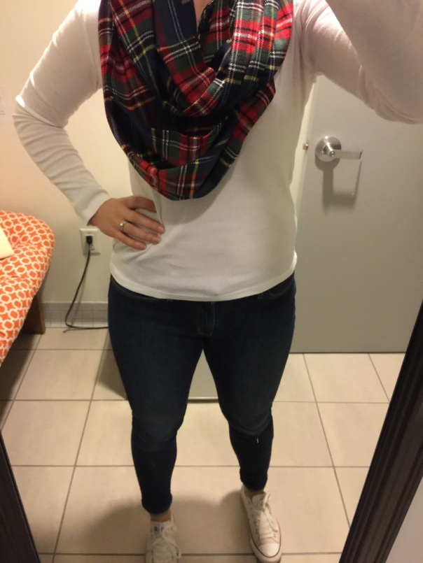 Plaid scarf, white long sleeved tee, black jeans, white Converse